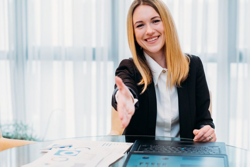 women recruiter offering to shake hand